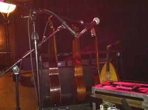 The Axe-Man cometh!  David Lindley's instruments, including a massive baritone Hawaiian guitar, normal Hawaiian guitar, bouzouki and oud.